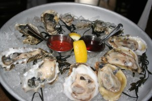 A dozen fresh oysters from the Bistro are offered on the half shell.  You can also order red or green oyster shooters for $3 each.