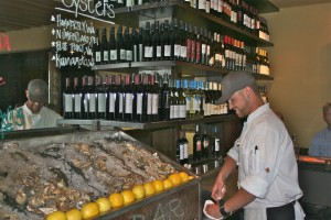 Rendezvous Bistro&#039;s Executive Chef Joel Tate shucks fresh oysters at the newly renovated raw bar.