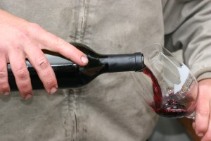 Anthony Schroth pours a taste of the Catch and Release zinfandel. The first of this vintage (lot 10, because the grapes were grown and picked in 2010) will be released in December.