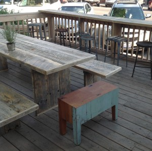 A Salt Lake City artist, whom Ali met through MADE, built the custom tables and benches from wood reclaimed from an old bridge spanning the Great Salt Lake. The Salt-Lake soaked slats were weathered in the desert for a year before becoming the rustic seating at Persephone. The same source found the collection of vintage industrial stools.