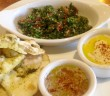 A small tasting of FIGS baba gnash, hummus and tabbouli, served with house-made pita.