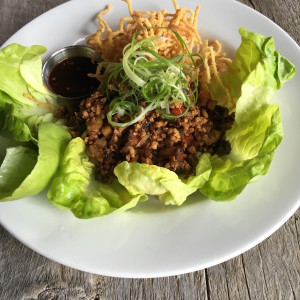 Chinese lettuce cups with stir-fried chicken, shitake mushrooms, sesame oil, crispy ramen noodles; a great shared plate or a hearty salad option.